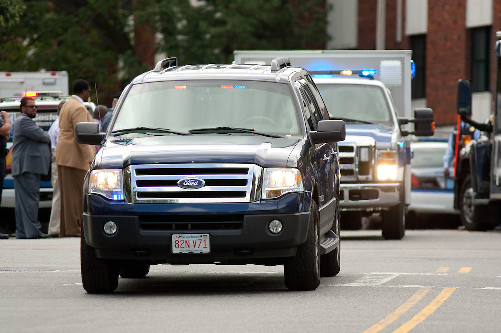 Boston, MA 08/10/2011.A convoy of Boston Police vehicles carrying the suspect in Wednesday's fatal shooting departs the scene at 17 Ledgemere Rd. in Brighton.   .Alex Jones / www.alexjonesphoto.com