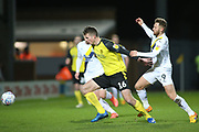 Conor Shaughnessy of Burton Albion (16) and Matty Taylor of Oxford United (9) battle for the ball during the EFL Sky Bet League 1 match between Burton Albion and Oxford United at the Pirelli Stadium, Burton upon Trent, England on 11 February 2020.