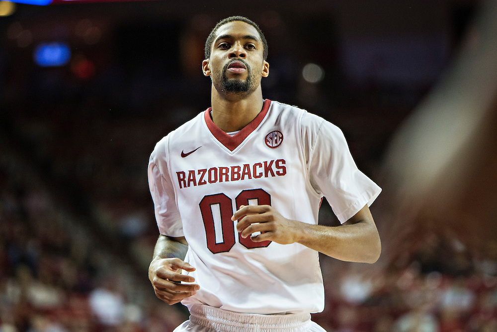 FAYETTEVILLE, AR - NOVEMBER 18:  Rashad Madden #00 of the Arkansas Razorbacks jogs down the floor during a game against the SMU Mustangs at Bud Walton Arena on November 18, 2013 in Fayetteville, Arkansas.  The Razorbacks defeated the Mustangs 89-78.  (Photo by Wesley Hitt/Getty Images) *** Local Caption *** Rashad Madden