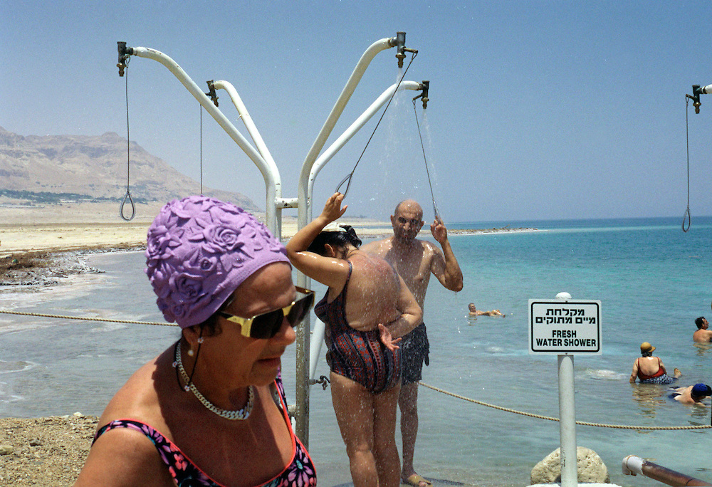 Israeli elders enjoy  the summer sun at the En Gedi spa in the Dead Sea in Israeli Saturday July 7, 2001. Despite the 11 months of violence Israelis and Palestinians take a break to enjoy the mediterrenean beaches and the Dead Sea, where under growing tensions and in the case of Gaza under closure people try to  make the best of their summer and carry on a normal life.