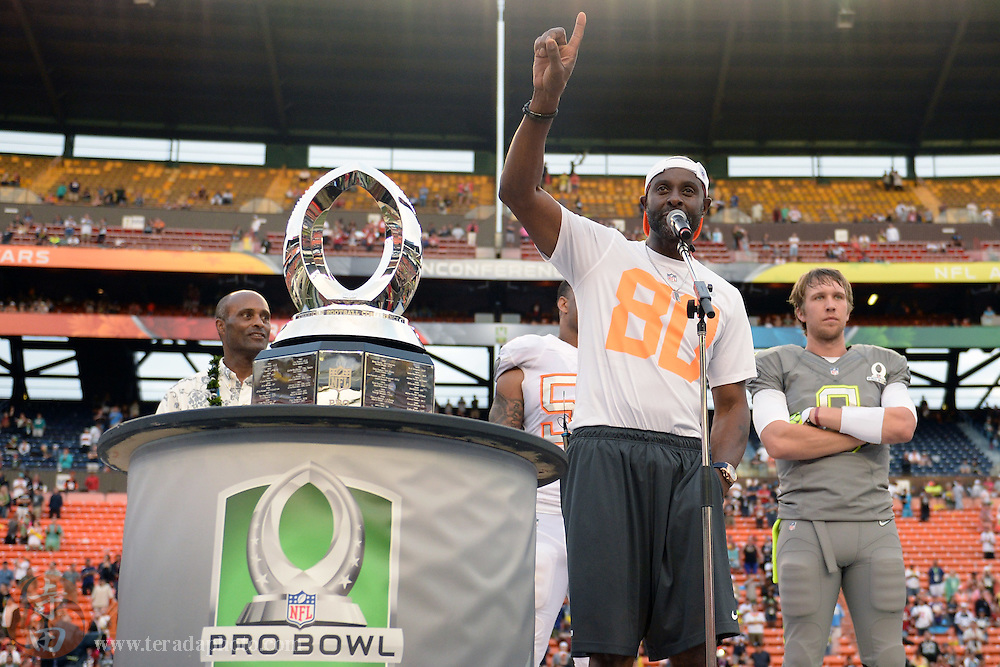 January 26, 2014; Honolulu, HI, USA; Team Rice alumni captain Jerry Rice celebrates with the championship trophy after the 2014 Pro Bowl against Team Sanders at Aloha Stadium. Team Rice defeated Team Sanders 22-21.