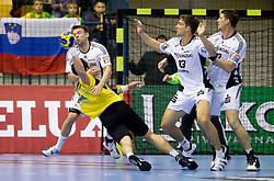 Christian Sprenger of Kiel vs Alem Toskic (#10) of Celje during the handball match between RK Celje Pivovarna Lasko (SLO) and TWH Kiel (GER) in 4th Round of Velux EHF Men's Champions League, on October 17, 2010 in Arena Zlatorog, Celje, Slovenia.  (Photo By Vid Ponikvar / Sportida.com)