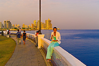 People stroll around the Balboa Monument, with Panama Bay and Downtown Panama City behind, Panama City, Panama