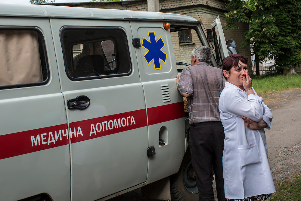 VOLNOVAKHA, UKRAINE - MAY 22:  A nurse cries as the bodies of Ukrainian soldiers killed during an attack on a military checkpoint earlier in the day by unknown forces are carried into the morgue on May 22, 2014 in Volnovakha, Ukraine. Authorities reported fifteen soldiers were killed and 31 injured. (Photo by Brendan Hoffman/Getty Images) *** Local Caption ***