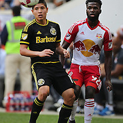 HARRISON, NEW JERSEY- OCTOBER 16:  Cristian Martinez #18 of Columbus Crew and Kemar Lawrence #92 of New York Red Bulls in action during the New York Red Bulls Vs Columbus Crew SC MLS regular season match at Red Bull Arena, on October 16, 2016 in Harrison, New Jersey. (Photo by Tim Clayton/Corbis via Getty Images)