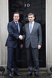 © licensed to London News Pictures. London, UK 21/01/2013. Prime minister David Cameron (left) and Prime Minister of Estonia, Andrus Anslip posing outside No10 in Downing Street on Monday 21 January, 2013. Photo credit: Tolga Akmen/LNP