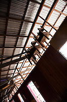 Chairs hanging in the common balcony area of Nanga Sumpa Longhouse are part of a ritual for the dead.