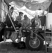 People hanging out in makeshift tent, Glastonbury, Somerset, 1989