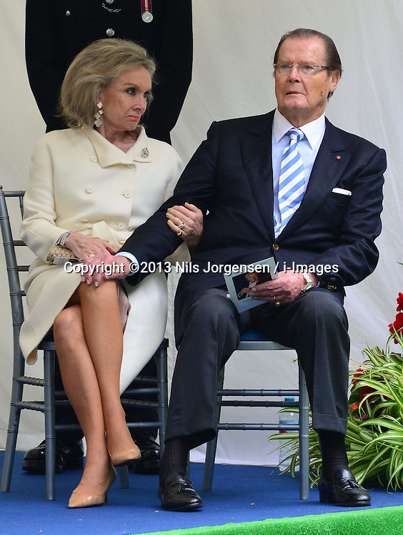 Michael Winner public memorial.  <br /> Kristina Tholstrup with Sir Roger Moore during the Memorial.<br /> Memorial takes place at the National Police Memorial. The film director and food critic helped establish, following his death on January 23 2013. <br /> Geraldine Winner, Sir Michael Parkinson, Sir Michael Caine, Sir Roger Moore, Cilla Black, Carol Vorderman, Sir Terence Conran, give eulogies, <br /> London, United Kingdom<br /> Sunday, 23rd June 2013<br /> Picture by Nils Jorgensen / i-Images