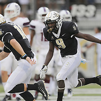 ORLANDO, FL - SEPTEMBER 08:  Adrian Killins Jr. #9 of the UCF Knights celebrates his touchdown with McKenzie Milton #10 of the UCF Knights during a football game against the South Carolina State Bulldogs at Spectrum Stadium on September 8, 2018 in Orlando, Florida. (Photo by Alex Menendez/Getty Images) *** Local Caption *** Adrian Killins Jr.; McKenzie Milton