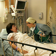 Anesthesiologist Susan Banez-Fogler gives Anna a final exam before entering the operating room, checking for any obstructions in her throat.