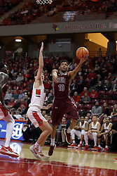 08 February 2018:  Aaron Cook gets in a layup after passing defenderMatt Hein during a College mens basketball game between the Southern Illinois Salukis and Illinois State Redbirds in Redbird Arena, Normal IL