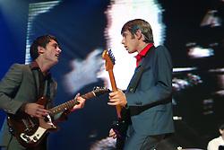 Nicholas McCarthy & Alex Kapranos of Franz Ferdinand, on stage at Prince's Street Gardens, Edinburgh, Scotland, August 2005..©Pic : Michael Schofield...