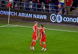 CARDIFF, WALES - Thursday, September 6, 2018: Wales' Connor Roberts (right) celebrates scoring the fourth goal with team-mate David Brooks during the UEFA Nations League Group Stage League B Group 4 match between Wales and Republic of Ireland at the Cardiff City Stadium. (Pic by Laura Malkin/Propaganda)