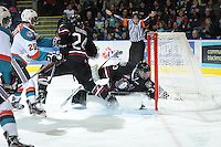 KELOWNA, CANADA - FEBRUARY 18: Deven Dubyk #33 of the Red Deer Rebels defends the net as the Red Deer Rebels visit the Kelowna Rockets on February 18, 2012 at Prospera Place in Kelowna, British Columbia, Canada (Photo by Marissa Baecker/Shoot the Breeze) *** Local Caption ***