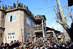 March 22, 2019 - Srinagar, Kashmir, India - Kashmiri people attend the funeral of an 11 year old civilian boy Atif Mir who was killed during a gun battle between Indian Government forces and suspected foreigner Militants in Hajin area of Bandipora district, Indian Administered Kashmir on 22 March 2019. Indian government forces have killed 8 rebels in 4 separate gunfights across Kashmir. Atif was killed after he was allegedly kept hostage by militants during gunfight, police said. (Credit Image: © Muzamil Mattoo/NurPhoto via ZUMA Press)