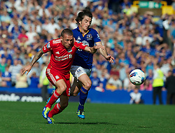 LIVERPOOL, ENGLAND - Saturday, October 1, 2011: Liverpool's Craig Bellamy and Everton's Leighton Baines during the Premiership match at Goodison Park. (Pic by David Rawcliffe/Propaganda)