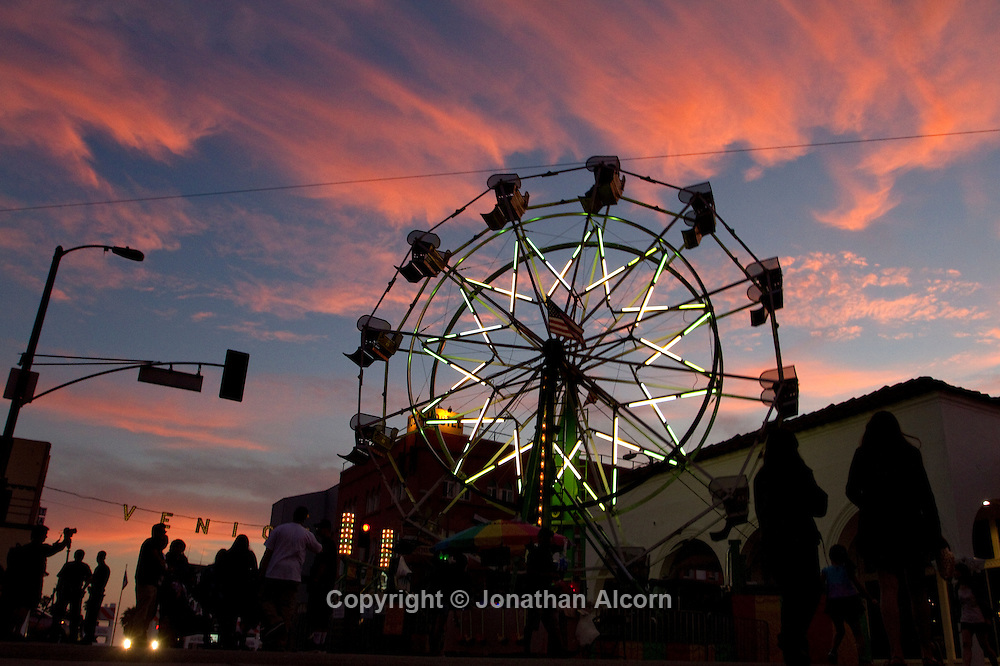 "Ferris wheel with the VENICE sign in the background at  ""Summer Carnival at the Beach? hosted by the LAPD West Bureau on July 13, 2012 in Venice Beach, California..©photo by Jonathan Alcorn"