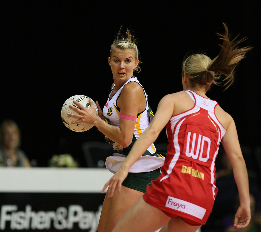 South Africa's Nadia Uys, left, looks to pass the ball round England's Sara Bayman in the New World Quad series netball match, Claudelands Arena, Hamilton, New Zealand, Thursday, November 01, 2012. Credit:SNPA / Dianne Manson.