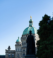 The statue of Queen Victoria rises in front of the parliament buildings in downtown Victoria.