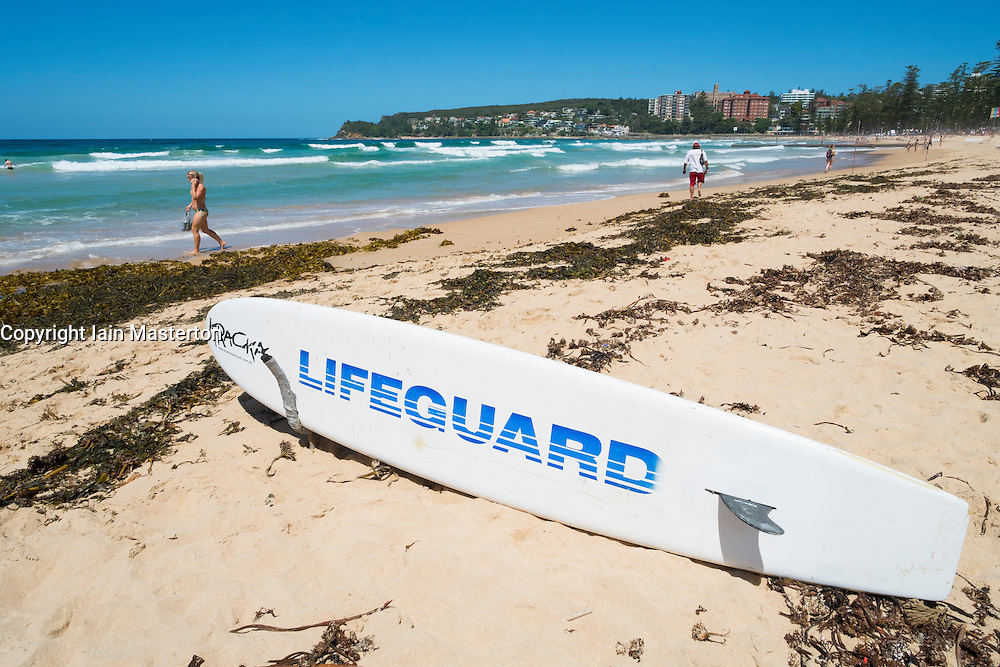 Lifeguard surfboard on beach at Manly Beach in Australia