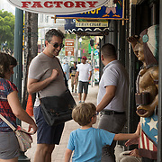 JUNE 9, 2016---MIAMI, FLORIDA<br /> Tourists walk along the storefronts in the heart of Miami's Little Havana neighborhood. The neighborhood has seen a resurgence of out of town visitors who eat latin food, drink coffee and smoke cigars, among other things.<br /> (Photo by Angel Valentin/Freelance)