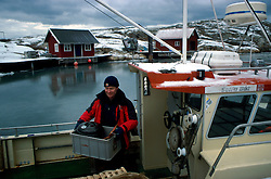 SWEDEN FJALLBACKA JAN04 - Swedish fisherman Per-Inge Bergman on his boat.. . jre/Photo by Jiri Rezac. . © Jiri Rezac 2004. Contact: +44 (0) 7050 110 417. Mobile:  +44 (0) 7801 337 683. Office:  +44 (0) 20 8968 9635. Email:   jiri@jirirezac.com. Web:    www.jirirezac.com