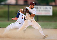 Mount Vernon second baseman Spencer Drahos (18) bobbles the ball as Iowa City Regina's Jake Brinkman (18) comes sliding in during the 2A District Finals game at West Branch High School in West Branch on Saturday, July 20, 2013.