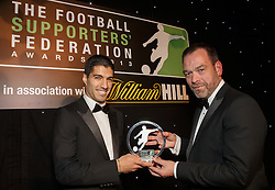 LONDON, ENGLAND - Monday, December 16, 2013: Liverpool's Luis Suarez receives the Player of the Year Award from Kristof Fahy Chief Marketing Officer at William Hill at the Football Supporters Federation Awards Night at the Emirates Stadium. (Pic by Steve Welsh/William Hill/Propaganda).