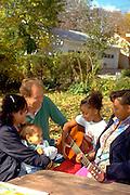 Mothers age 40, guitarist age 9, boy age 3, male age 50.  St Paul Minnesota USA