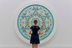 "© Licensed to London News Pictures. 23/06/2017. London, UK. A staff member views ""Contemplation"", 2007, by Damien Hirst (estimate GBP0.7-0.9m) at the preview of Sotheby's Contemporary Art Sale in New Bond Street.  The auction, which is dominated by Pop art, takes place on 28 June. Photo credit : Stephen Chung/LNP"
