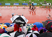 Runners warm up as rain falls on the track prior to 2014 MSHSAA Track Championships at Lincoln University on May 24, 2014 in Jefferson City, Mo. (David Welker | Special to the News-Press)