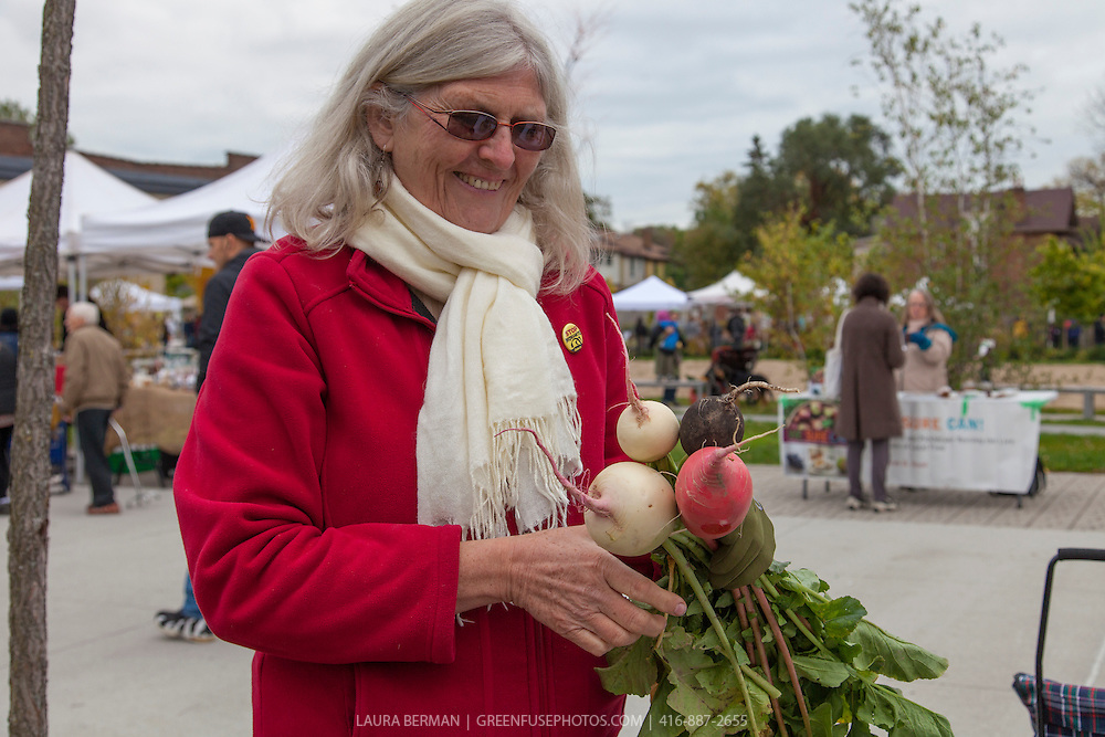 Colette Murphy with white, red and black turnips at Wychwood farmers Market