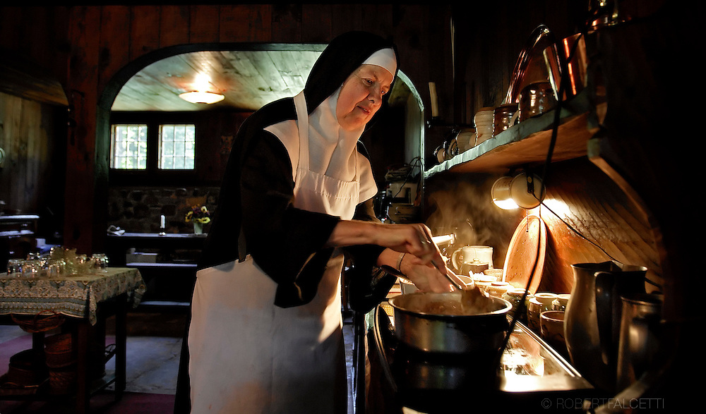 BETHLEHEM, CT- 11 OCTOBER 2005- 101105BF50-- Mother Catherine of Alexandria Talbot prepares to serve lunch to guests at St. Joseph's mens guest house at the Abbey of Regina Laudis. Mother Catherine handles the abbey's herb gardens and blends herbal teas. She entered the abbey in 1983 after a career as a chemist in the Washington, DC area.  .Photo by Robert Falcetti