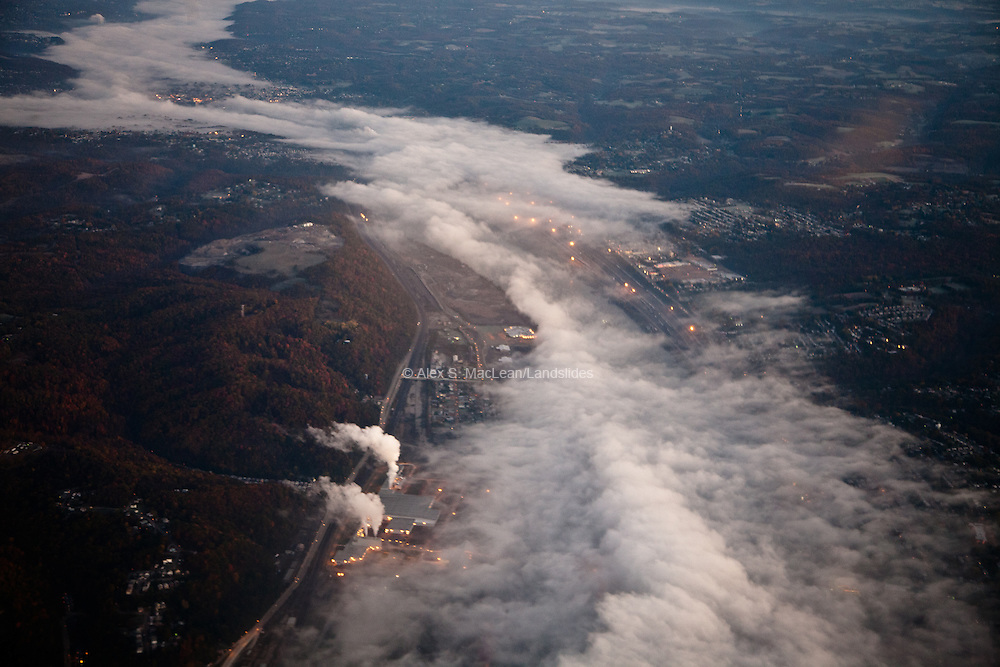 Twenty miles northwest of Pittsburgh, early morning fog follows the path of the Ohio River, reflecting the link between earth and atmosphere.