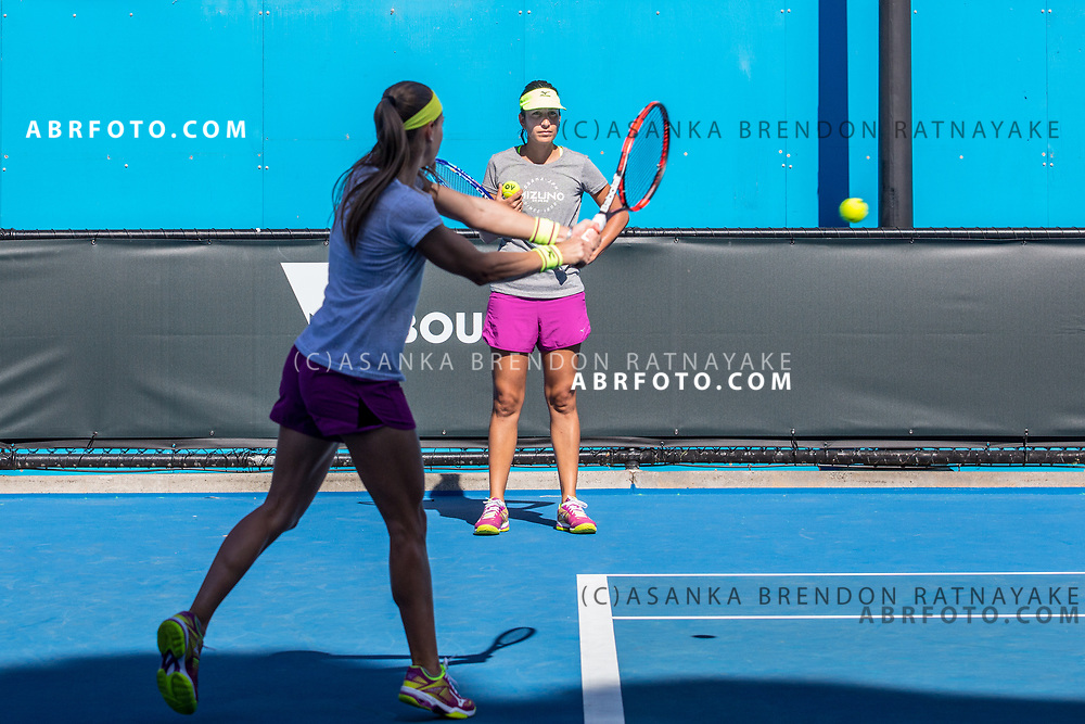 Coach, Elise Tamaëla looks on as Aleksandra Krunić plays a backhand shot during a training session at Melbourne Park in Melbourne, Australia on the 11th of January 2018. Asanka Brendon Ratnayake for The New York Times