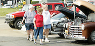 (from left) Carol Banks, Geneva Werst, Tom Banks and Melodie Davis, all of Piqua check out the cars during the Spectacular Summer Cruise-In & Concert at the Miami Valley Centre Mall in Piqua, July 2, 2011