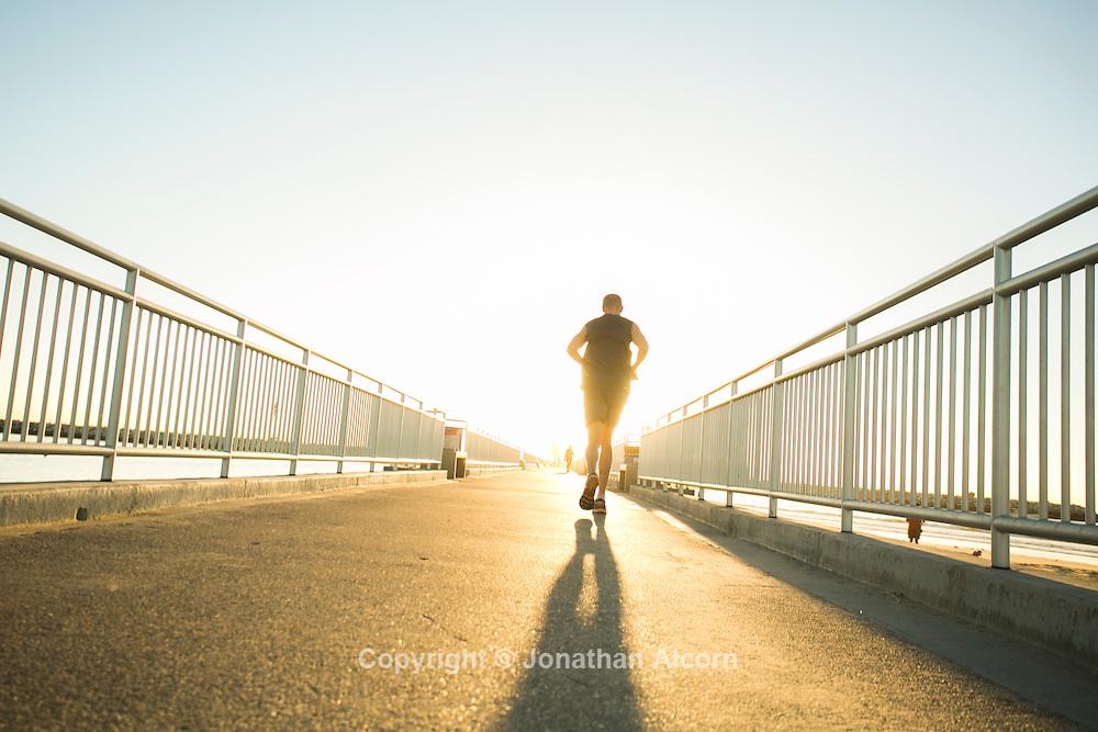 An older man jogs on the jetty at Marina del Rey near Los Angeles, California, U.S November 18, 2016.  Jonathan Alcorn