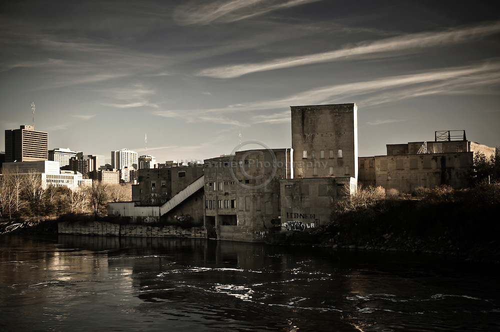 A dramatic image of an old mill on the shores of the Ottawa River.