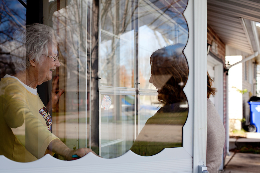 "Catherine Hoppenworth speaks with Horizons volunteer coordinator Anna Ronnebaum during her Meals on Wheels delivery in Cedar Rapids, Iowa on Thursday, November 19, 2015. Ronnebaum says that the visits are a good chance to check in with seniors, many of whom live alone. ""This route could take me an hour to do, but it usually takes me two because I like to talk to the clients,"" she says. (Rebecca F. Miller/Freelance for The Gazette)"