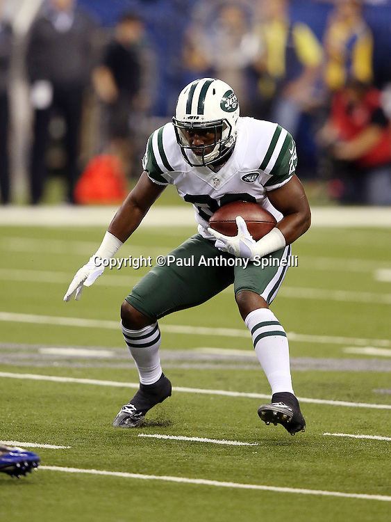 New York Jets running back Bilal Powell (29) runs the ball during the 2015 NFL week 2 regular season football game against the Indianapolis Colts on Monday, Sept. 21, 2015 in Indianapolis. The Jets won the game 20-7. (©Paul Anthony Spinelli)