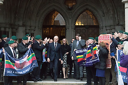 Royal Courts of Justice, London, February 8th 2017. As day two for the appeal hearing for 'Marine A' - Sgt Alex Blackman draws to a close, retired Marines and supporters gather on the steps of the High Court as his wife Claire emerges from the building. PICTURED: Claire Blackman, centre, emerges from the high court to cheers from supporters of her Husband Sgt Alex Blackman.