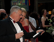 Joe Lehman of Fairfax, Virginia (left) and Kelly Weiler of Bellbrook look at one of the items in the silent auction during the 53rd Annual Art Ball at the Dayton Art Institute, Saturday, June 12, 2010.