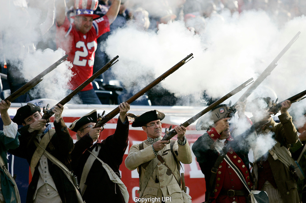 The New England Patriots end zone militia fire their rifles after the Patriots scored against the San Diego Chargers in the first quarter at Gillette Stadium in Foxboro, Massachusetts on September 18, 2011.  The Patriots defeated the Chargers 35-21.   UPI/Matthew Healey