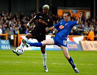 Photo: Ed Godden.<br />Barnet v Stockport County. Coca Cola League 2. 29/04/2006. Tresor Kandal (L) is challenged by Stockport's David Beharall.