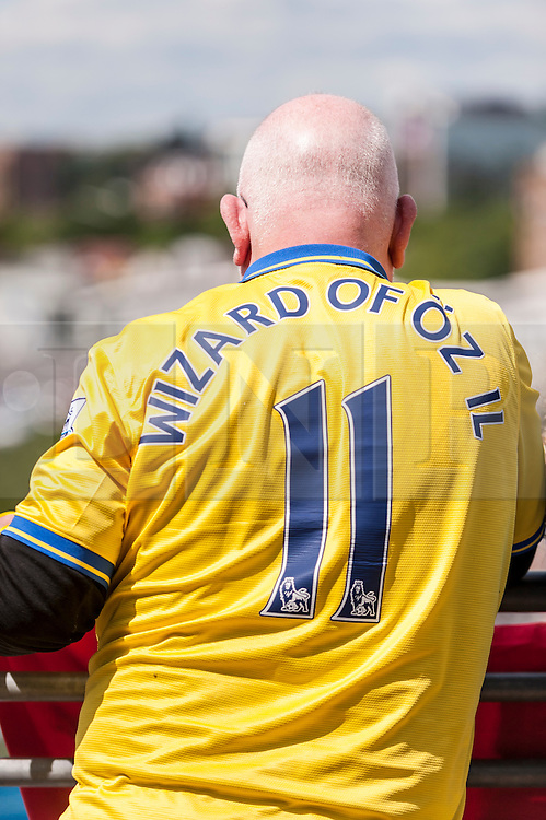 © Licensed to London News Pictures. 30/05/2015. London, UK. An Arsenal fan wears a shirt supporting Mezut Ozil, as fans gather at Wembley Stadium for the FA Cup Final 2015, between Arsenal and Aston Villa. Photo credit : Stephen Chung/LNP