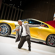 Usain Bolt gestures to fans at Nissan HQ.