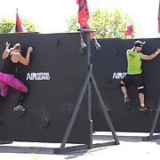 Competitors in action during the Reebok Spartan Race. Mohegan Sun, Uncasville, Connecticut, USA. 28th June 2014. Photo Tim Clayton