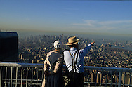 New York. Amish family watching the city from the terrace - the top  of the world - , on the world trade center tower: panoramic view on the city  New York  Usa  view from the top  of the world   /  une famille Amish - menonites - admire la Vue panoramique sur New York depuis la terasse du world trade center.