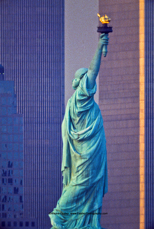 Statue of Liberty in front of World Trade Center